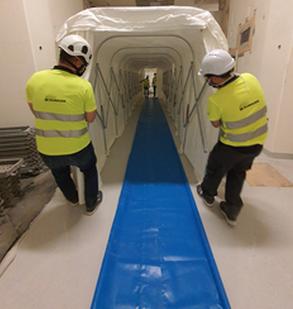 DR Technologie - Hommes déployant un tunnel sécurisé